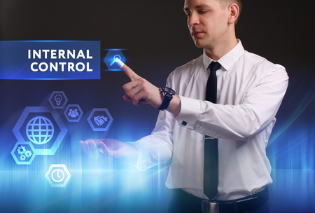 keywords link: Business, Technology, Internet and network concept. Young businessman working on a virtual screen of the future and sees the inscription: Internal control