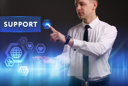 keywords link: Business, Technology, Internet and network concept. Young businessman working on a virtual screen of the future and sees the inscription: Support