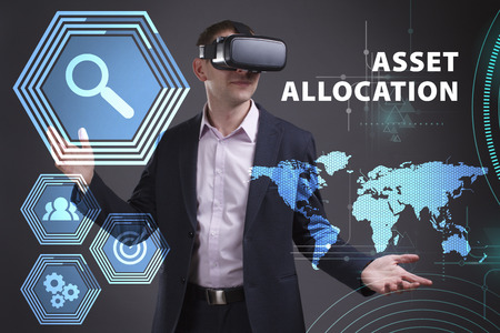 digital asset management: Business, Technology, Internet and network concept. Young businessman working on a virtual screen of the future and sees the inscription: Asset allocation Stock Photo