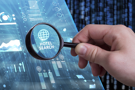 keywords link: Business, Technology, Internet and network concept. Young businessman working on a virtual screen of the future and sees the inscription: Hotel search