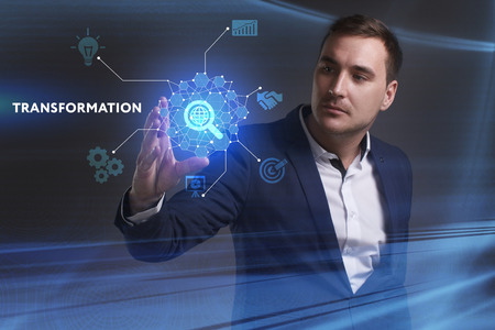 keywords link: Business, Technology, Internet and network concept. Young businessman working on a virtual screen of the future and sees the inscription: Transformation
