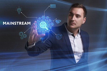 keywords link: Business, Technology, Internet and network concept. Young businessman working on a virtual screen of the future and sees the inscription: Mainstream Stock Photo