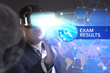keywords link: Business, Technology, Internet and network concept. Young businessman working in virtual reality glasses sees the inscription: Exam results Stock Photo