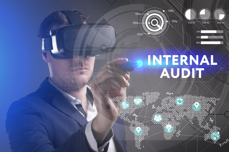 keywords link: Business, Technology, Internet and network concept. Young businessman working in virtual reality glasses sees the inscription: Internal audit