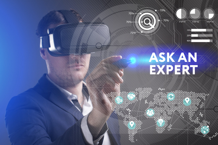 keywords link: Business, Technology, Internet and network concept. Young businessman working in virtual reality glasses sees the inscription: Ask an expert