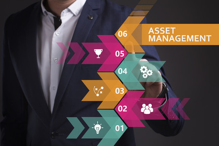 digital asset management: Business, Technology, Internet and network concept. Young businessman working on a virtual screen of the future and sees the inscription: Asset management