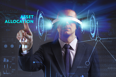 digital asset management: Business, Technology, Internet and network concept. Young businessman working in virtual reality glasses sees the inscription: Asset allocation Stock Photo