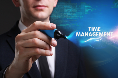 keywords link: Business, Technology, Internet and network concept. Young businessman working on a virtual screen of the future and sees the inscription: Time management Stock Photo