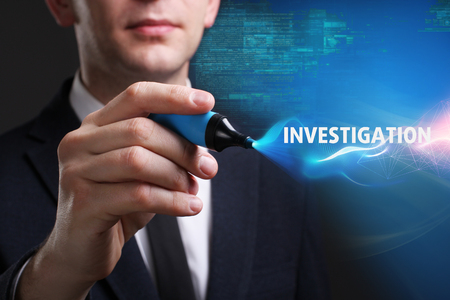 keywords link: Business, Technology, Internet and network concept. Young businessman working on a virtual screen of the future and sees the inscription: Investigation