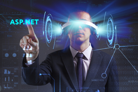keywords link: Business, Technology, Internet and network concept. Young businessman working in virtual reality glasses sees the inscription: ASP.NET