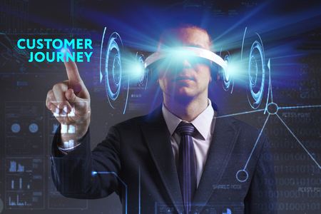 keywords link: Business, Technology, Internet and network concept. Young businessman working in virtual reality glasses sees the inscription: Customer journey