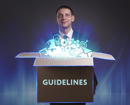 keywords link: Business, Technology, Internet and network concept. Young businessman shows the word: Guidelines
