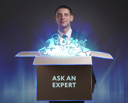 keywords link: Business, Technology, Internet and network concept. Young businessman shows the word: Ask an expert