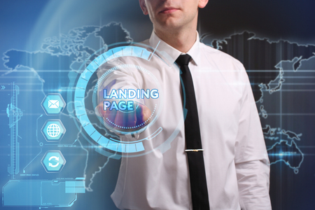 keywords link: Business, Technology, Internet and network concept. Young businessman working on a virtual screen of the future and sees the inscription: Landing page Stock Photo