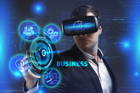customer support: Business, Technology, Internet and network concept. Young businessman working in virtual reality glasses sees the inscription: Business
