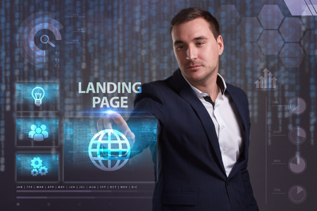 queries: The concept of business, technology, the Internet and the network. A young entrepreneur working on a virtual screen of the future and sees the inscription: Landing page