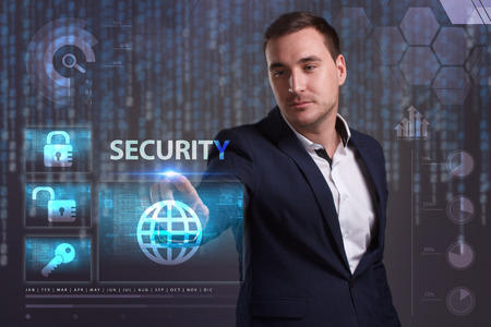 control fraud: The concept of business, technology, the Internet and the network. A young entrepreneur working on a virtual screen of the future and sees the inscription: Security