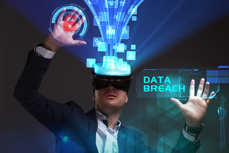 control fraud: Business, Technology, Internet and network concept. Young businessman working in virtual reality glasses sees the inscription: Data breach