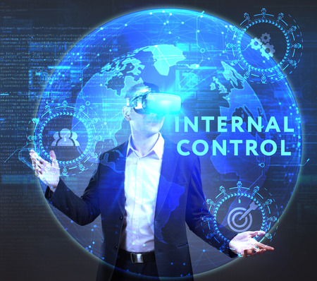 queries: The concept of business, technology, the Internet and the network. A young entrepreneur working on a virtual screen of the future and sees the inscription: Internal control