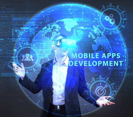 The concept of business, technology, the Internet and the network. A young entrepreneur working on a virtual screen of the future and sees the inscription: Mobile apps development Stock Photo