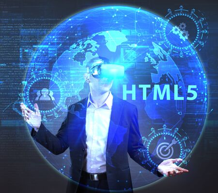 The concept of business, technology, the Internet and the network. A young entrepreneur working on a virtual screen of the future and sees the inscription: HTML5 Stock Photo