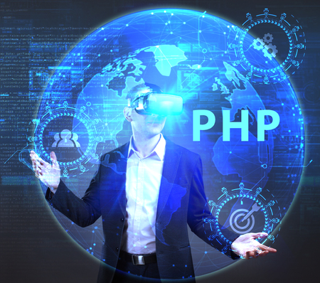The concept of business, technology, the Internet and the network. A young entrepreneur working on a virtual screen of the future and sees the inscription: PHP