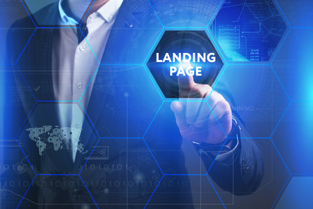 queries: Business, Technology, Internet and network concept. Young businessman working on a virtual screen of the future and sees the inscription: Landing page Stock Photo