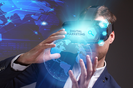 advice: Business, Technology, Internet and network concept. Young businessman working on a virtual screen of the future and sees the inscription: Digital Marketing Stock Photo