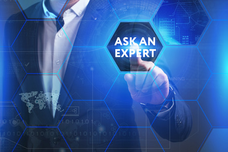 queries: Business, Technology, Internet and network concept. Young businessman working on a virtual screen of the future and sees the inscription: Ask an expert