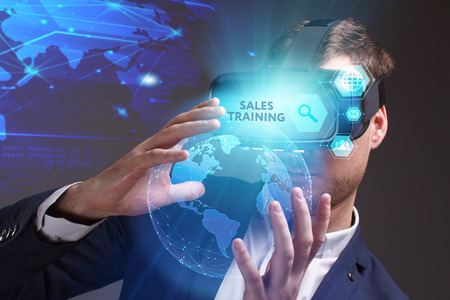 advice: Business, Technology, Internet and network concept. Young businessman working on a virtual screen of the future and sees the inscription: Sales training