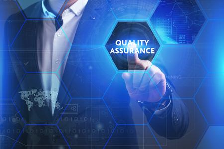 queries: Business, Technology, Internet and network concept. Young businessman working on a virtual screen of the future and sees the inscription: Quality assurance Stock Photo