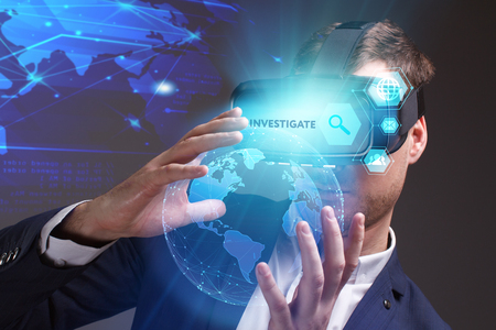 queries: Business, Technology, Internet and network concept. Young businessman working on a virtual screen of the future and sees the inscription: Investigate Stock Photo
