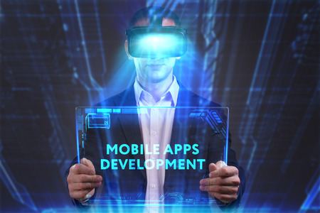 internet search: Business, Technology, Internet and network concept. Young businessman working in virtual reality glasses sees the inscription: Mobile apps development