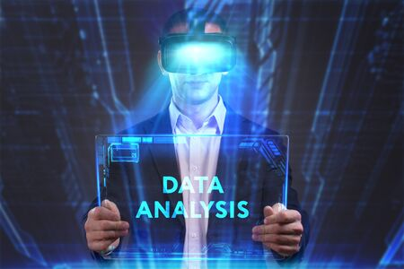 internet search: Business, Technology, Internet and network concept. Young businessman working in virtual reality glasses sees the inscription: Data analysis