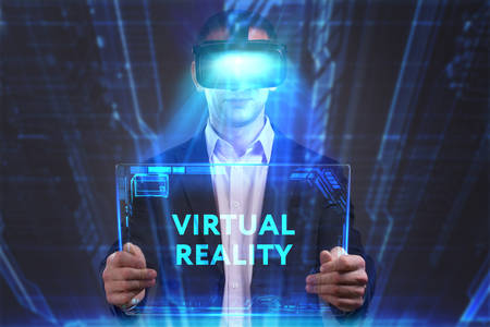 internet search: Business, Technology, Internet and network concept. Young businessman working in virtual reality glasses sees the inscription: Virtual reality Stock Photo