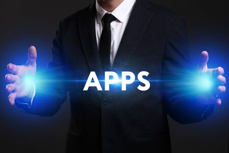 Business, Technology, Internet and network concept. Young businessman working on a virtual screen of the future and sees the inscription: APPS Stock Photo
