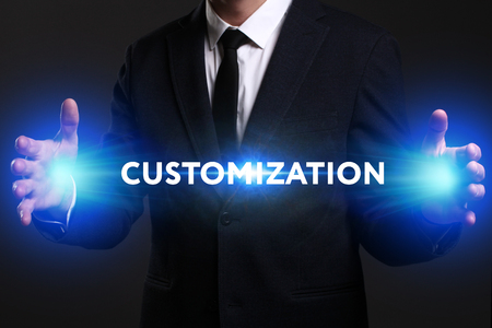 customization: Business, Technology, Internet and network concept. Young businessman working on a virtual screen of the future and sees the inscription: Customization