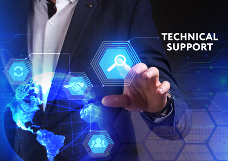 The concept of business, technology, the Internet and the network. A young entrepreneur working on a virtual screen of the future and sees the inscription: Technical support