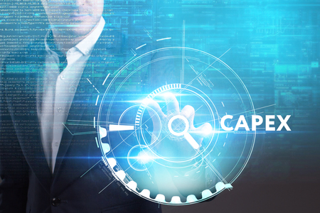 Business, Technology, Internet and network concept. Young businessman working on a virtual screen of the future and sees the inscription: Capex Stock Photo