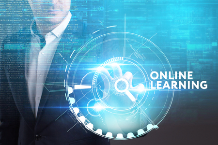 Business, Technology, Internet and network concept. Young businessman working on a virtual screen of the future and sees the inscription: Online learning