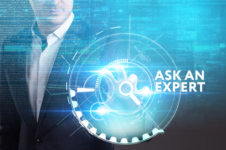Business, Technology, Internet and network concept. Young businessman working on a virtual screen of the future and sees the inscription: Ask an expert