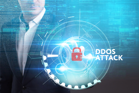 Business, Technology, Internet and network concept. Young businessman working on a virtual screen of the future and sees the inscription: Ddos attack Stock Photo