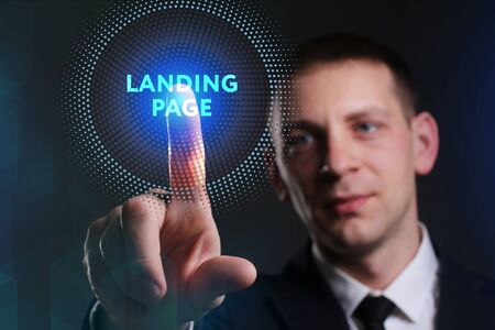 keywords: Business, Technology, Internet and network concept. Young businessman working on a virtual screen of the future and sees the inscription: Landing page Stock Photo