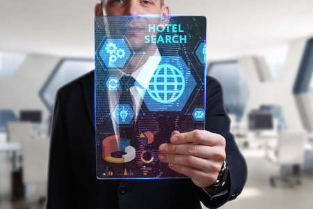 Business, Technology, Internet and network concept. Young businessman working on a virtual screen of the future and sees the inscription: Hotel search