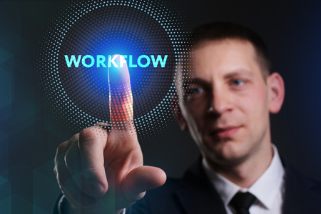 niche: Business, Technology, Internet and network concept. Young businessman working on a virtual screen of the future and sees the inscription: Workflow