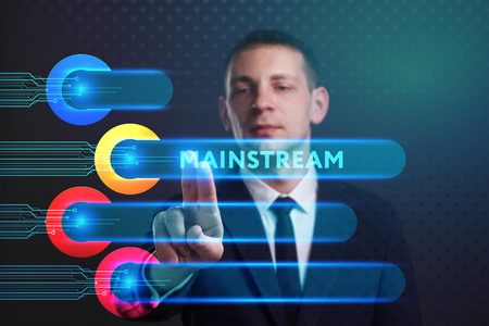 keywords: Business, Technology, Internet and network concept. Young businessman working on a virtual screen of the future and sees the inscription: Mainstream Stock Photo