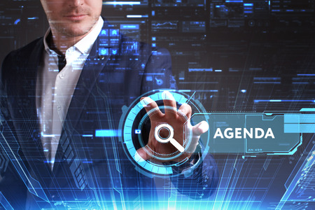 keywords: Business, Technology, Internet and network concept. Young businessman working on a virtual screen of the future and sees the inscription: Agenda