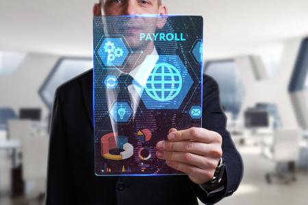 ビジネス、技術、インターネット、ネットワークのコンセプトです。未来の仮想画面に取り組んでいる青年実業家と碑文を見ている: 給与 写真素材