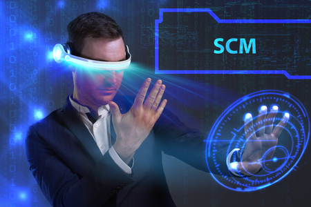 scm: Business, Technology, Internet and network concept. Young businessman working on a virtual screen of the future and sees the inscription: SCM
