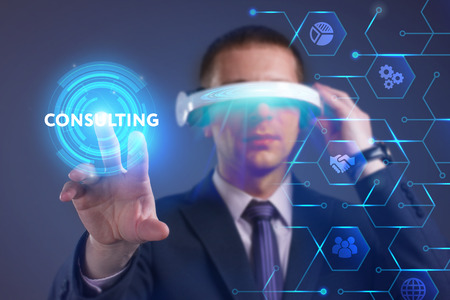 niche: Business, Technology, Internet and network concept. Young businessman working on a virtual screen of the future and sees the inscription: Consulting